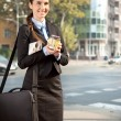Businesswoman with coffee — Stock Photo