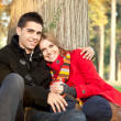 Young love couple relaxing in park - Stockfoto