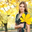 Beautiful girl with leaf — Stock Photo