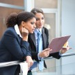 Two businesswomen talking about the job — Stock Photo
