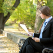 Businesswoman reading document, outdoor — Stock Photo