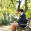 Stock Photo: Businesswomhaving breakfast in park