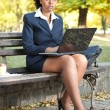 Businesswoman in park - Stockfoto