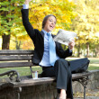 Winner businesswoman in park — Stock Photo
