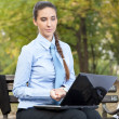 Serious businesswoman looking in lap top — Stock Photo #7801787