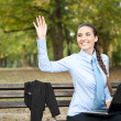 Businesswoman waving hello — Stock Photo