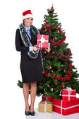 Woman with gift near christmas tree — Stock Photo