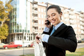 Businesswoman on the phone checking the time — Stock Photo