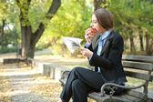 Businesswoman eating apple — Stock Photo