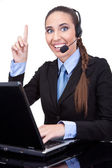 Businesswoman working as phone operator — Stock Photo