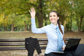 Businesswoman waving hello — Stock Photo