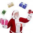 Santa Claus throwing and playing with presents — Stock Photo #7932549