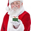 Santa Claus holding and offering a gift — Stock Photo #7932575