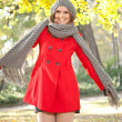 Funny fashion girl in autumn park — Stock Photo