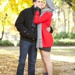 Love girl kissing her boyfriend — Stock Photo
