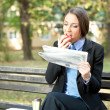Businesswoman relaxing in park — Stock Photo