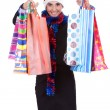 Santa girl with shopping bags — Stock Photo