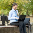 Businesswoman with laptop on break — Stock Photo