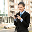 Businesswoman with smart phone — Stock Photo