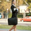 Businesswoman with coffee walking — Stock Photo
