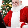 Modern Santa using laptop — Stock Photo