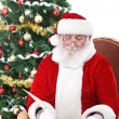 Santa writing list gifts — Stock Photo