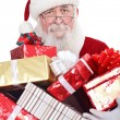 Santa holding presents — Stock Photo