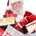 Santa holding presents — Stock Photo