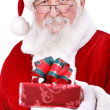 Santa Claus giving gift — Stock Photo #7933314