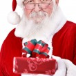 Santa Claus giving gift — Stock Photo