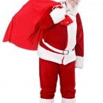 Santa bringing presents — Stock Photo