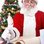 Santa writing Christmas list — Stock Photo
