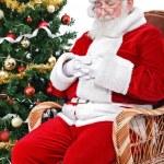 Santa sleeping in his char — Stock Photo