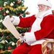 Santa Claus reading wish list — Stock Photo