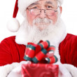 Santa giving present for Christmas — Stock Photo