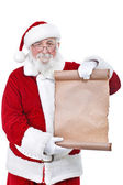 Santa holding blank scroll list — Стоковое фото