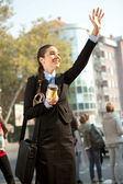 Smiling businesswoman waving hello — Stock Photo