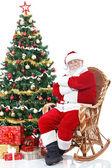 Santa claus sitter i gungstol — Stockfoto