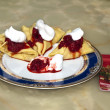 Pancakes with whipped cream and strawberries -  