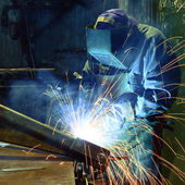 Welder in a factory — Fotografia Stock