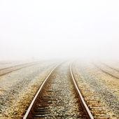 Railway in fog — Stock Photo