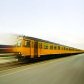 Yellow train in full speed — Stock Photo