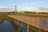 Walkway over a marsh to the Bodie Island lighthouse — Stok fotoğraf