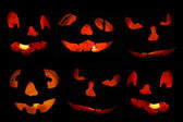 Jack o'lantern faces fill the frame — Stockfoto