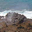 Spray from the Halona Blowhole in Hawaii - Stockfoto