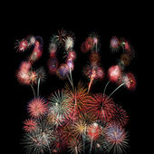The year 2012 written in fireworks over multiple colorful blasts — Zdjęcie stockowe