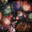 Multicolored fireworks fill the frame - Foto Stock