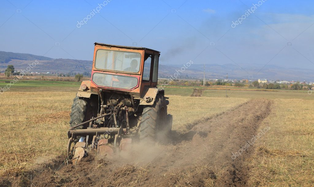 Image of a field with a tractor ploughing.  — Stock Photo #6829071