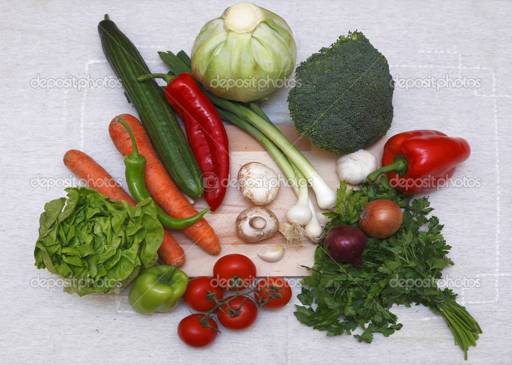 Upper view of various salad ingredients on a table cloth.  Stock Photo #6947418