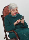 Old woman with mobile phone — Stock Photo